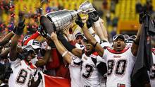 Members of the Calgary Stampeders hold the Grey Cup trophy after defeating the Montreal Alouettes to win CFL's 96th Grey Cup football game in Montreal November 23, 2008. (TODD KOROL)