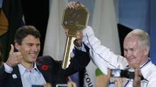 John Furlong, CEO of VANOC, right, accepts the Olympic Village key from Vancouver Mayor Gregor Robertson in November, 2009. (Lyle Stafford/Lyle Stafford for the Globe and Mail)