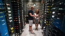 Kevin and Merle Jarvis are seen in the wine cellar at their Vancouver on Thursday. 'It's a practical wine cellar, not a serious collection,' Kevin says. (DARRYL DYCK/THE GLOBE AND MAIL)