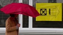A woman carries an umbrella as she enters a polling station to vote in the federal election in Sidney, B.C., on Vancouver Island, on Monday May 2, 2011. (Darryl Dyck/ The Canadian Press/Darryl Dyck/ The Canadian Press)