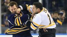 Boston Bruins left wing Milan Lucic (17) and Buffalo Sabres center Paul Gaustad (28) fight at the start of the first period at the First Niagara Center. (Kevin Hoffman-US PRESSWIRE/US PRESSWIRE)