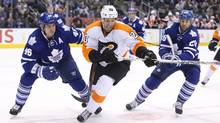 Philadelphia Flyers centre R.J. Umberger (20) goes after the puck against Toronto Maple Leafs defenceman Roman Polak (46) and centre Daniel Winnik (26) at the Air Canada Centre in Toronto on Saturday, Feb. 20, 2016. (Tom Szczerbowski/USA Today Sports)