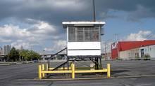 """A detail from the John Massier photograph """"parking lot guard tower"""" (John Massier)"""