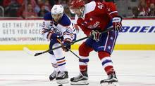 Leon Draisaitl of the Edmonton Oilers and Tom Wilson of the Washington Capitals go after the puck in the third period at Verizon Center on Feb. 24, 2017. (Rob Carr/Getty Images)