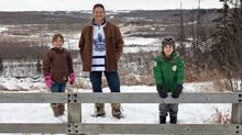 Torontonian turned Westerner Jay Palter pictured with his kids Ella Palter and Ben Palter in a park near their home in Edmonton, Alberta. The family moved to Edmonton two and a half years and are enjoying the Western Canadian lifestyle. (Jason Franson/The Canadian Press)