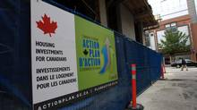 A Government of Canada economic action plan sign hangs on a fence at a social housing project under construction at Abbott St. and West Pender St. in Vancouver, B.C., on Monday May 24, 2010. (DARRYL DYCK For The Globe and Mail)
