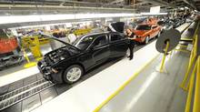 Chrysler employees assemble cars at the assembly plant in Brampton, Ont. (Kevin Van Paassen/The Globe and Mail)