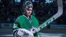 Dallas Stars goalie Kari Lehtonen waves to the crowd after being named the number one star of the game against the Pittsburgh Penguins at the American Airlines Center. (Jerome Miron/USA Today Sports)