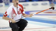 Canada's skip Kevin Koe shouts to his teammates against Denmark during the World Men's Curling Championships in Beijing, March 29. (CHINA DAILY/REUTERS)