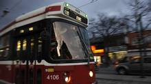 510 streetcar on Spadina Ave. in Toronto's Chinatown on December 10, 2012. (Fred Lum/The Globe and Mail)
