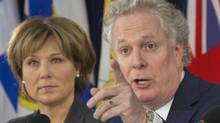 Quebec Premier Jean Charest gestures as British Columbia Premier Christy Clark looks on after a winter meeting of the provincial premiers on health care in Victoria, January 17, 2012. (ANDY CLARK/ANDY CLARK/REUTERS)