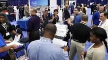 Jobseekers talk with recruiters at a job fair in Washington in this file photo taken June 11, 2013. (JONATHAN ERNST/REUTERS)