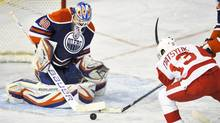 Edmonton Oilers' goalie Devan Dubnyk (L) stops Detroit Red Wings' Pavel Datsyuk during the second period of their NHL hockey game in Edmonton March 15, 2013. (DAN RIEDLHUBER/REUTERS)