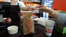 Customers buy a coffee and donut from a Dunkin' Donuts store on Wellington Street in Verdun, Queb. (Christinne Muschi For The Globe and Mail)