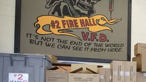 This mural in a Vancouver Downtown Eastside fire station will come down 'sooner rather than later,' said Wade Pierlot, assistant chief of operations for the fire department.