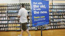 A customer peruses movie titles at a Blockbuster outlet (Kevin Van Paassen/Kevin Van Paassen/The Globe and)