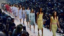 Rose petals rained on Burberry Prorsum's catwalk during London Fashion Week. (SUZANNE PLUNKETT)