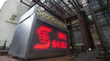An electronic sign posting financial data is shown outside the Scotiabank building in Toronto, Thursday, Apr.9, 2015. (Frank Gunn/THE CANADIAN PRESS)