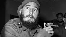 Fidel Castro holds a cigar during a news conference in Havana in 1961. The hand-rolled cigar held a certain cachet during the 1990s in the United States, the number of American smokers has declined. Castro died at age 90 on Nov. 25, 2016. (AP)