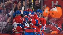 Paul Byron #41 of the Montreal Canadiens is smothered by his teammates as they celebrate his third period goal during the NHL game against the Boston Bruins at the Bell Centre on November 8, 2016 in Montreal, Quebec, Canada. The Montreal Canadiens defeated the Boston Bruins 3-2. (Minas Panagiotakis/Getty Images)