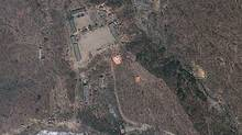 In this April 18, 2012 file satellite image provided by GeoEye appears to show a train of mining carts, at the lower center of the frame, and other preparations underway at North Korea's Punggye-ri nuclear test site but no indication of when a detonation might take place, according to analysis by the U.S.-Korea Institute at Johns Hopkins School of Advanced International Studies. (GeoEye Photo/AP/GeoEye Photo/AP)