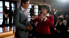 """Vancouver Mayor Gregor Robertson, left, and B.C. Premier Christy Clark talk before the Vancouver Art Gallery announces the exhibition """"The Forbidden City: Inside the Court of China's Emperors"""" would be coming to the gallery on Oct. 21, 2013. (DARRYL DYCK for The Globe and Mail)"""