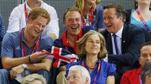 Britain's Prince Harry (L) and Prime Minister David Cameron (R) watch the track cycling event at the Velodrome during the London 2012 Olympic Games August 2, 2012. (Cathal McNaughton/Reuters)