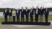 Canadian Prime Minister Stephen Harper (third from right) waves with leaders of the G8 and European Union as they pose for the G8 leaders family photo at Lough Erne near Enniskillen, Ireland, Tuesday, June 18, 2013. (Adrian Wyld/THE CANADIAN PRESS)