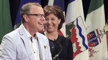 British Columbia premier Christy Clark (R) smiles as she and Brad Wall, premier of Saskatchewan, make an announcement during the Council of the Federation summit in Charlottetown, Prince Edward Island, August 29, 2014. REUTERS/Christinne Muschi (CANADA - Tags: POLITICS) (CHRISTINNE MUSCHI/REUTERS)
