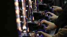Although casinos are illegal in Japan, pachinko generates some $200-billion (U.S.) in revenue each year – about the same as Toyota Motor Corp. (KIM KYUNG-HOON/REUTERS)
