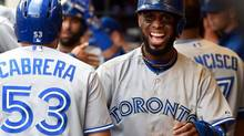 Toronto Blue Jays shortstop Jose Reyes (7) smiles in the dugout after scoring in the sixth inning during the game against the Milwaukee Brewers at Miller Park on Aug 20, 2014. (Benny Sieu/USA Today Sports)
