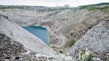The open pit of the now-closed Jeffrey mine is seen Wednesday, August 10, 2016 in Asbestos, Que. THE CANADIAN PRESS/Paul Chiasson