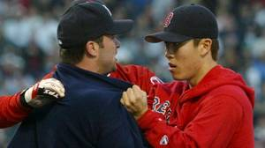 Boston Red Sox relief pitcher Byung-Hyun Kim (R) and New York Yankees outfielder David Dellucci tussel during the American League Championship Series, in Boston, October 11, 2003.