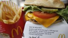 A McDonald's burger and fries in a restaurant in Washington, July 23, 2010. (MOLLY RILEY/MOLLY RILEY/REUTERS)
