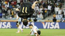 FILE - The July 3, 2010 file photo shows Germany's Miroslav Klose celebrating after scoring during the World Cup quarterfinal soccer match between Argentina and Germany at the Green Point stadium in Cape Town, South Africa. (Associated Press)