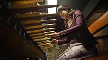 Minako Uchino, a medical doctor at Toronto's Princess Margaret Hospital, will play the carillon at theUniversity of Toronto's Soldier's Tower for Remembrance Day. (Jennifer Roberts for The Globe and Mail)
