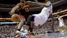 Cleveland Cavaliers' Tristan Thompson (13) collides with Philadelphia 76ers' Thaddeus Young (21) and is fouled during the first half of an NBA basketball game, April 14, 2013, in Philadelphia. (Michael Perez/AP)