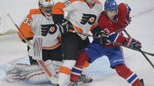 Montreal Canadiens' Brendan Gallagher, right, pressures Philadelphia Flyers' goalie Brian Boucher as Flyers' Brayden Schenn (10) defends during first period NHL hockey action in Montreal, Saturday, February 16, 2013. (Graham Hughes/THE CANADIAN PRESS)