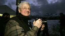 Film critic Roger Ebert stands in the photographers line at the premiere of The Night Listener at the Sundance Film Festival in Park City, Utah January 21, 2006. (MARIO ANZUONI/REUTERS)