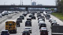 Cars in dense urban cores may diminish in number but are expected to remain a significant transit option in the suburbs. (Fred Lum/The Globe and Mail)