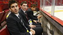 NHL prospects John Tavares, Matt Duchene and Brayden Schenn watch the Detroit Red Wings practice before Game 3 of the NHL Stanley Cup final. (SHAUN BEST)