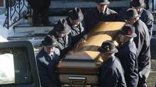 Pallbearers carry Mr. Rizzuto's casket. (CHRISTINNE MUSCHI FOR THE GLOBE AND MAIL)