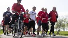 Ontario Premier and Liberal Leader Kathleen Wynne, second right, is joined by MPPs, Liberal candidates and supporters as she runs along the waterfront in Toronto on Monday, May 19, 2014, as she continues her election campaign. (Chris Young/THE CANADIAN PRESS)