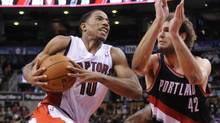 Toronto Raptors shooting guard DeMar DeRozan (10) drives the ball to the basket with Portland Trail Blazers center Robin Lopez (42) defending during the fourth quarter of a game at the Air Canada Centre. Portland won the game 118-110. (MARK KONEZY/USA TODAY SPORTS)
