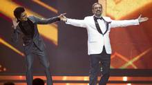 Show hosts Ritesh Deshmukh (left) and Boman Irani jest on stage at the start of the 2011 International Indian Film Academy Awards ceremony in Toronto on Saturday, June 25. (Chris Young/CP)