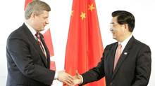 Stephen Harper and Hu Jintao: What a difference six years make (CHRIS WATTIE/REUTERS)