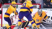Johnny Gaudreau of the Calgary Flames loses the puck in front of Jonathan Quick, Drew Doughty and Tanner Pearson of the Los Angeles Kings during the second period at Staples Center on February 23, 2016 in Los Angeles, California. (Harry How/Getty Images)