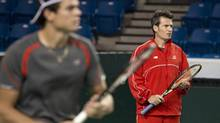 Team Canada's Milos Raonic (L) and coach Galo Blanco during practice prior to the Davis Cup tennis tournament in Vancouver, British Columbia January 30, 2013. The matches, which will feature Canada vs. Spain is set for Friday, Saturday and Sunday. (BEN NELMS For The Globe and Mail)