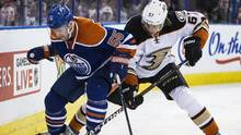 Anaheim Ducks' David Perron (57) and Edmonton Oilers' Mark Letestu (55) vie for the puck during second period NHL action, in Edmonton on Tuesday, Feb. 16, 2016. THE CANADIAN PRESS/Codie McLachlan (CODIE MCLACHLAN/THE CANADIAN PRESS)