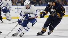 Mitch Marner skates with the puck in front of Sabres centre Derek Grant on Thursday. (Timothy T. Ludwig/USA Today Sports)